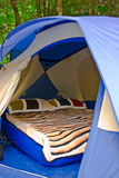 Comfortable Camping. Tent with inflatable bed inside stock photos