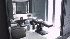 Comfortable chair and couch for washing hair and head massage in spa salon. Interior modern hairdressing salon with. Equipment for hair and skin care stock footage