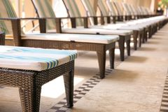 Comfortable chaise longues. At resort royalty free stock image