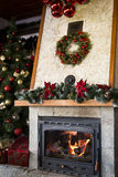 Comfortable christmas decorated fireplace Stock Images