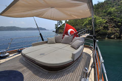 Comfortable coach. At the deck of luxury yacht Royalty Free Stock Photos