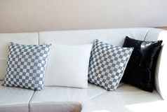 Comfortable corner. In family room, with multi-colored pillows Royalty Free Stock Image