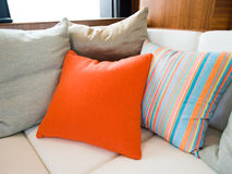 Comfortable corner. In family room, with multi-colored pillows Royalty Free Stock Photography