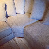 Comfortable corner sofa with lots of cushions Royalty Free Stock Photography
