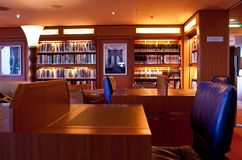 Comfortable Cruise Ship Library. The comfortable library of a large cruise ship stock photo