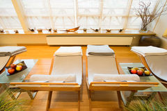 Comfortable deck chairs in spa room Royalty Free Stock Photography