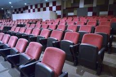 Comfortable empty red seats. In cinema room Stock Photo