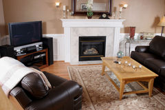 Comfortable Family Room. A welcoming family/living room with leather furniture and a plasma tv royalty free stock photography