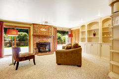 Comfortable family room with brich fireplace Royalty Free Stock Photo