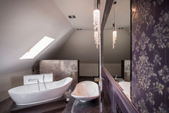Comfortable freestanding bath stock photography