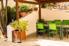 Comfortable furniture, tables and chairs on a spacious terrace in the summer royalty free stock images