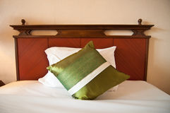 Comfortable gren pillows and bed Stock Photos