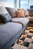 Comfortable grey couch with pillows royalty free stock photo