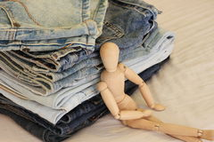 Comfortable Jeans. Puppet sitting beside Jeans, peace and comfortable Royalty Free Stock Images