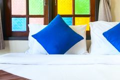Comfortable king bed with blue pillows. And bright color window glass Stock Photo