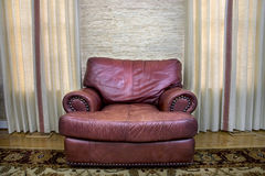 Comfortable leather couch. Sitting in a room between two windows Stock Image
