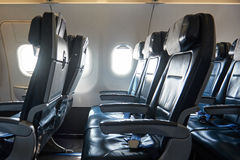 Comfortable leather seats in airplane royalty free stock image