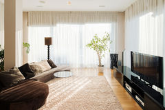 Comfortable living room with long sofa and tv set. royalty free stock photography