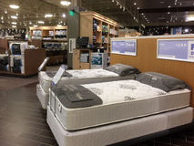 Comfortable mattress sale at furniture market Stock Image