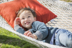 Comfortable Mixed Race Boy Relaxing in Hammock. Cute Mixed Race Boy Relaxing in His Hammock Stock Photo