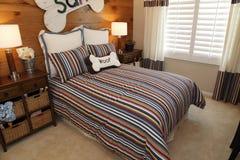 Comfortable modern designer bedroom. Royalty Free Stock Images