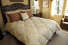 Comfortable modern designer bedroom. Royalty Free Stock Image