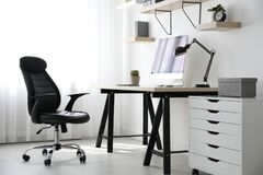 Free Comfortable Office Chair Near Table With Modern Computer Royalty Free Stock Photo - 212776545