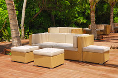 Comfortable outdoor furniture. In the warm afternoon sun Royalty Free Stock Photo