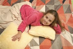 Comfortable pajamas for relax. Girl little kid wear soft cute pajamas while relaxing on bed. Pajamas and bedroom textile royalty free stock photo