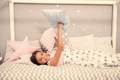 Comfortable pillow. Girl smiling child lay bed star pattern pillows and plaid bedroom. Bedclothes for children. Girl kid royalty free stock photos