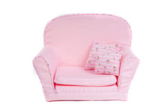 Comfortable Pink armchair with two pillows on it. Tiny pink armchair with pillows on it isolated on white background Royalty Free Stock Images