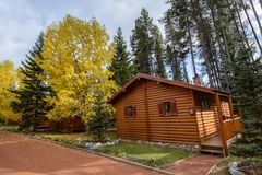Comfortable quiet wooden hotel at the multicolored fall forest Stock Photography