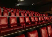 Comfortable reclining chairs in a modern movie theater stock images