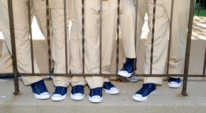 Comfortable shoes. Image of a guys in khaki's and blue tennis shoes Stock Image