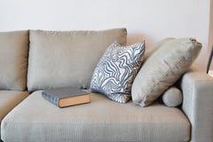 Comfortable sofa with grey striped pillows Stock Photos