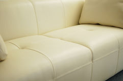 Comfortable sofa at home. Comfortable white leather sofa at home Stock Photography