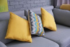 Comfortable sofa with pillows. In living room Royalty Free Stock Photography