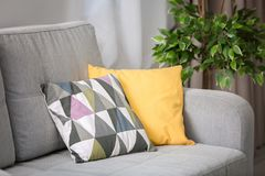 Comfortable sofa with pillows. In living room Stock Photo
