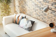 Comfortable sofa with pillows. In room Stock Photography