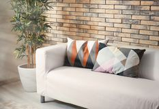 Comfortable sofa with pillows. In room Stock Images