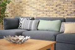 Comfortable sofa with pillows. In room Royalty Free Stock Image