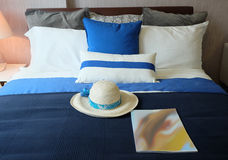 Comfortable soft bed in room Stock Photo