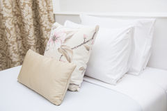 Comfortable soft pillows on the bed Stock Photos