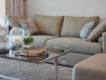 Comfortable velvet sofa with grey striped pillows in modern living room Stock Photo