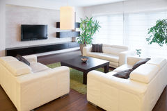 Comfortable white sofas. At living room Stock Images