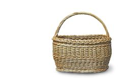 Comfortable wicker basket on a white background. Royalty Free Stock Photos