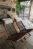 Comfortable wooden chairs in the backyard Stock Image