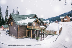 Comfortable wooden cottage in the ski resort Royalty Free Stock Images