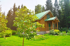 Comfortable wooden log house at the recreation center in Zyuratkul National park in Satka, Southern Urals, Russia Royalty Free Stock Photography