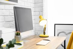 Comfortable workplace with computer on desk royalty free stock photos